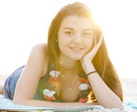 Brunette girl at the beach in sunrise. Royalty Free Stock Photos