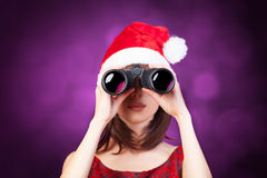 Brunette girl with binocular Stock Photos