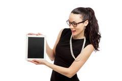 Brunette girl in black dress holding ipad. Brunette girl in black dress hodling ipad over white background royalty free stock images