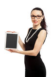 Brunette girl in black dress holding ipad. Brunette girl in black dress hodling ipad over white background stock photos