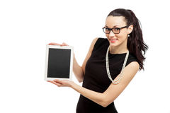 Brunette girl in black dress holding ipad Royalty Free Stock Images