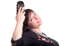 Brunette girl in black dress play guitar Royalty Free Stock Photos