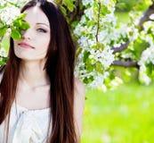 Brunette girl in blossom garden Royalty Free Stock Photos