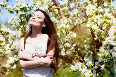 Brunette girl in blossom garden Stock Photo