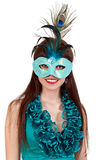 Brunette girl in a blue dress and mask Stock Image