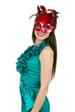 Brunette girl in a blue dress and mask Stock Images