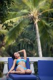 Brunette girl in blue swimming suit Stock Images