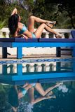 Brunette girl in blue swimming suit Royalty Free Stock Images