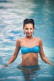 Brunette girl in blue swimming suit Royalty Free Stock Photo