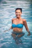 Brunette girl in blue swimming suit Royalty Free Stock Image