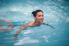 Brunette girl in blue swimming suit Royalty Free Stock Photography