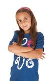 Brunette girl in blue top with her arms folded Royalty Free Stock Images