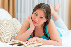 Brunette girl with a book Royalty Free Stock Photo