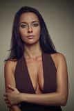 Brunette girl in brown dress. Big breasts Royalty Free Stock Image