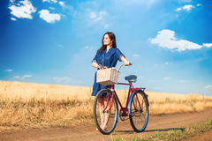 Brunette girl with bycicle Stock Image