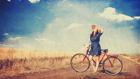 Brunette girl with bycicle Stock Photo