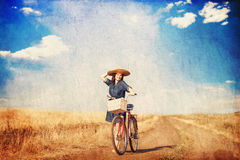 Brunette girl with bycicle Royalty Free Stock Images