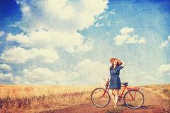 Brunette girl with bycicle Stock Images