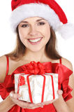 A brunette girl in a Christmas suit with a present Stock Photos