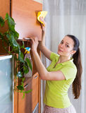 Brunette girl cleaning wooden furiture Stock Images