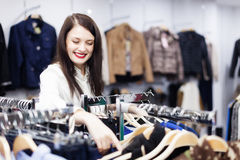 Brunette girl at clothing store Royalty Free Stock Photography