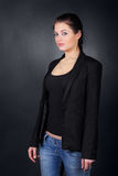 Brunette girl in coat stand Royalty Free Stock Photo