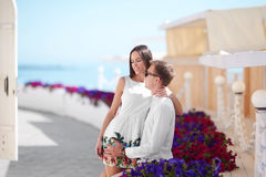 A brunette girl and a confident young man on a summer holiday. Happy honeymoon of a fall-in-love couple. Romance and dating. A romantic couple hugging near a Royalty Free Stock Image