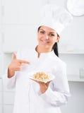 Brunette girl cook Stock Image