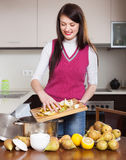 Brunette girl cooking pear jam Royalty Free Stock Images