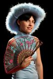 Brunette girl with cowboy hat and spanish fan. Isolated on black Stock Images