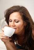 Brunette girl with cup of drink royalty free stock photos