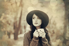Brunette girl with cup in the park Stock Image