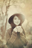 Brunette girl with cup in the park Royalty Free Stock Image