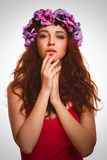 Brunette girl curly woman in wreath of flowers Stock Photo
