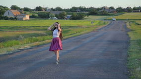 Brunette girl dancing on a road stock video footage
