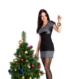 Brunette girl decorates the Christmas tree balls Stock Photos