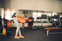 Brunette girl doing exercise indoor Royalty Free Stock Photo