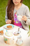 Brunette girl drinking tea at cafe terrace Royalty Free Stock Images