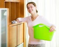 dusting furniture. brunette girl dusting furniture at home stock image e