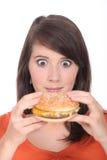 Brunette girl eating Burger Royalty Free Stock Photos