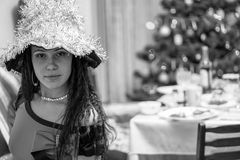 Brunette girl face in witch costume. Black and white Stock Photography