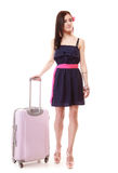 Brunette girl female tourist in dress with suitcase. Travel tourism. Full length of brunette girl in black pink dress. Female tourist young woman with suitcase royalty free stock image