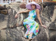 Brunette girl in flower dress and pink hat Royalty Free Stock Photo