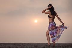 Brunette girl in flower skirt and brown bra Stock Image