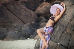 Brunette girl in flower skirt and pink hat Royalty Free Stock Photo