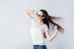 Brunette girl with fluttering hair Stock Photo