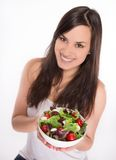Brunette girl with fresh salad Stock Photography