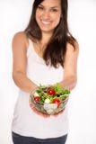 Brunette girl with fresh salad Stock Photo