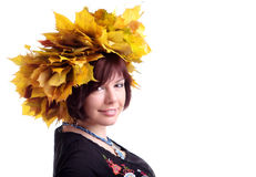 Brunette girl with garland of yellow leaves. European brunette short-haired girl in black dress with garland of yellow maple leaves on head Stock Photography