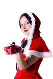Brunette girl with a gift for Christmas Stock Photos